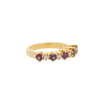 Ruby and diamond half band 18 carat yellow gold.