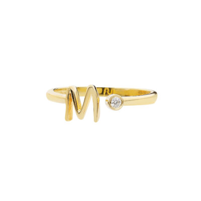 """Letter """"M"""" 18 carat yellow gold ring with a diamond."""