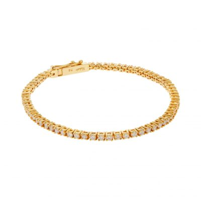 Diamond tennis bracelet in 18 carat yellow gold.